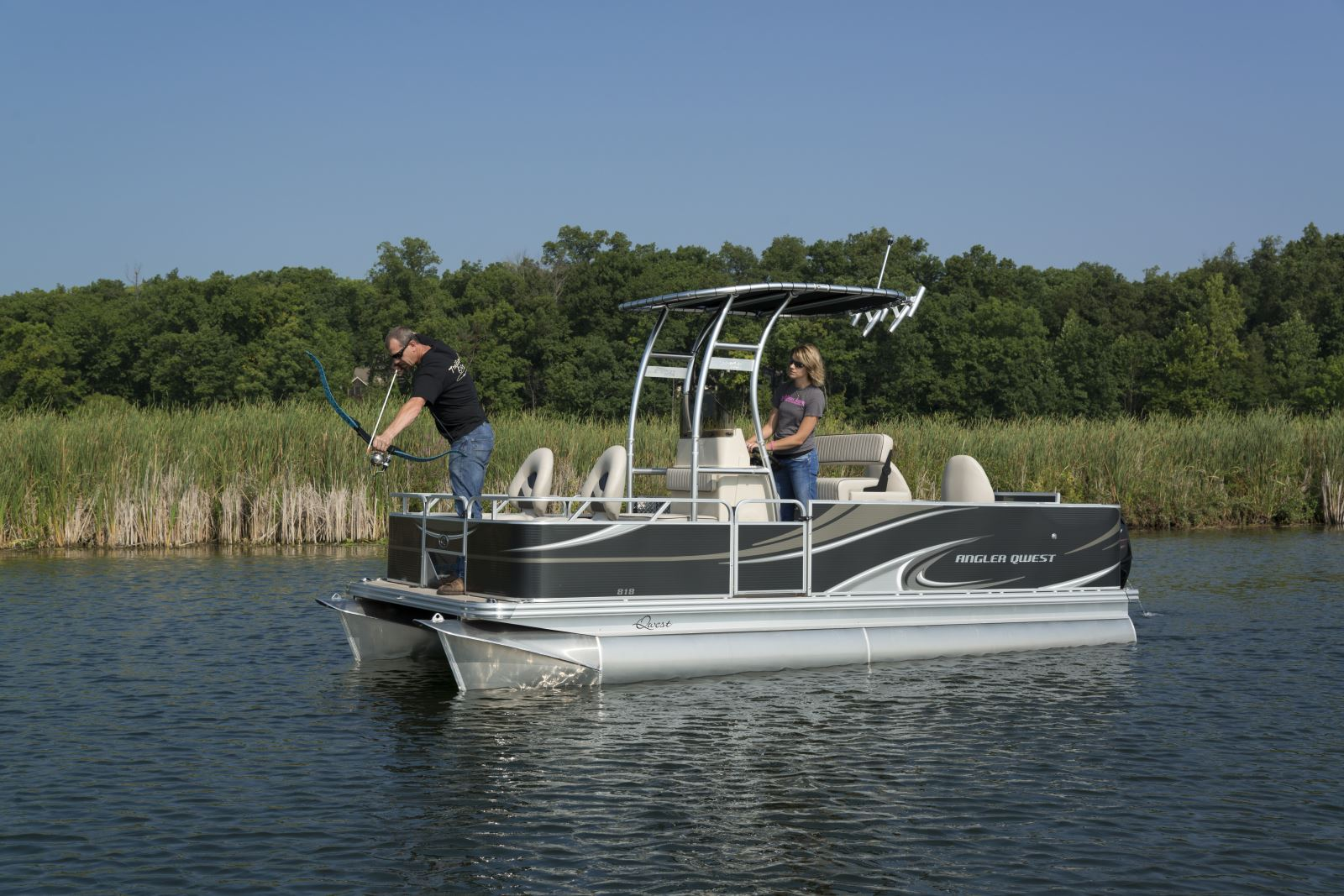 Bowfishing exercising archery angle pontoon deck boat for Bow fishing boats